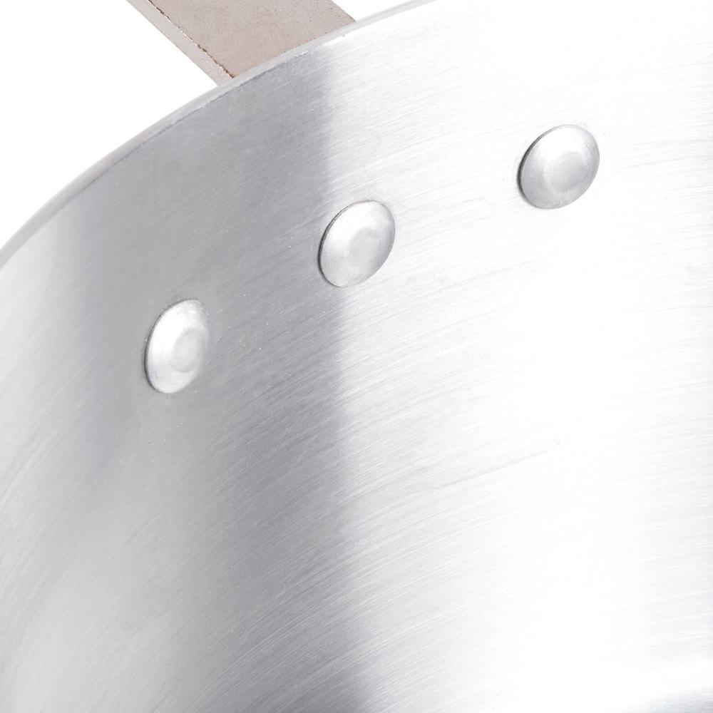 Close up of three rivets on an aluminum pan
