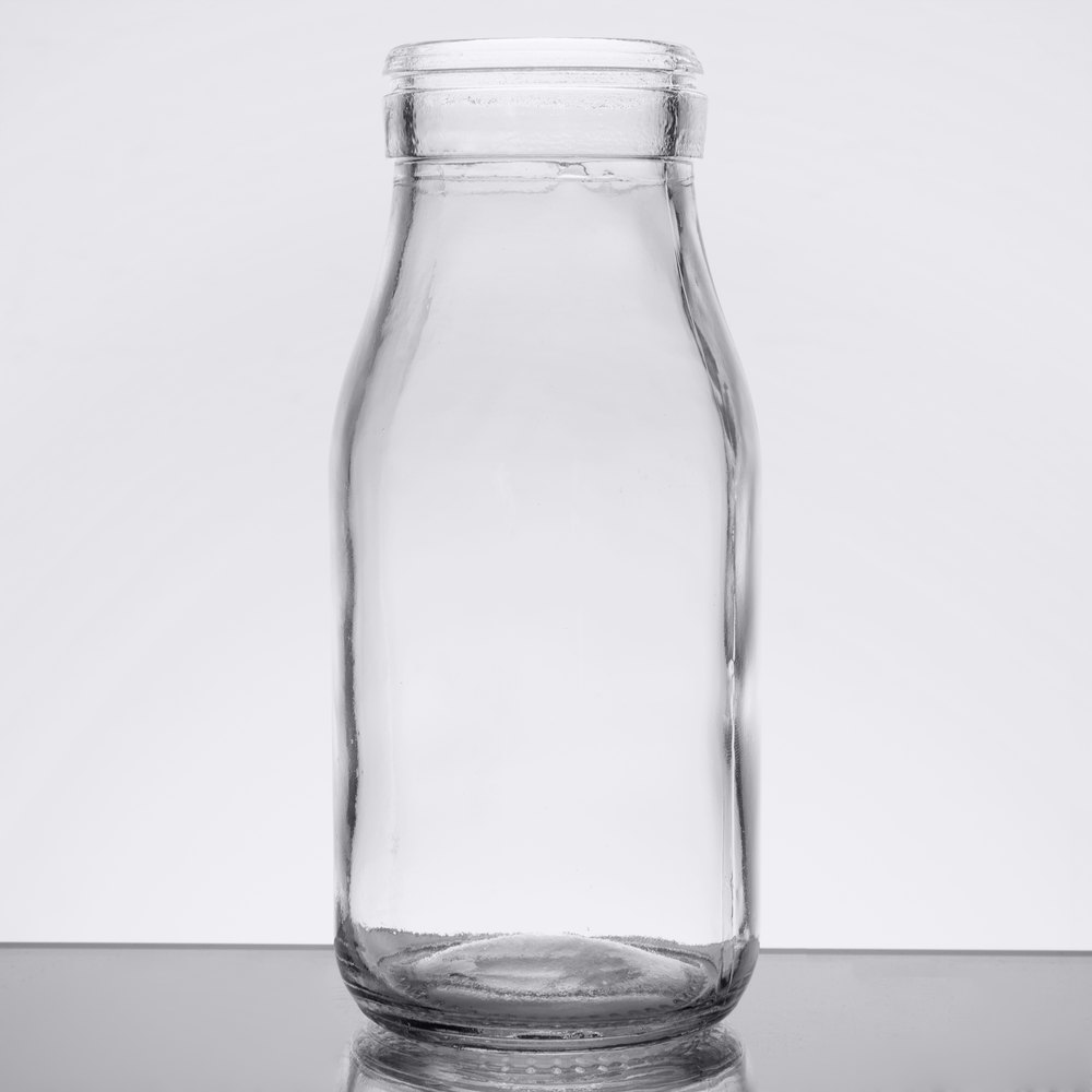 Clear glass milk bottle on a table top