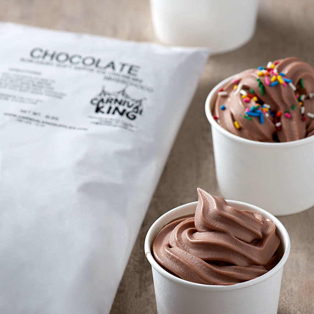 Bag of Carnival King chocolate soft serve ice cream mix with cups filled with chocolate soft serve