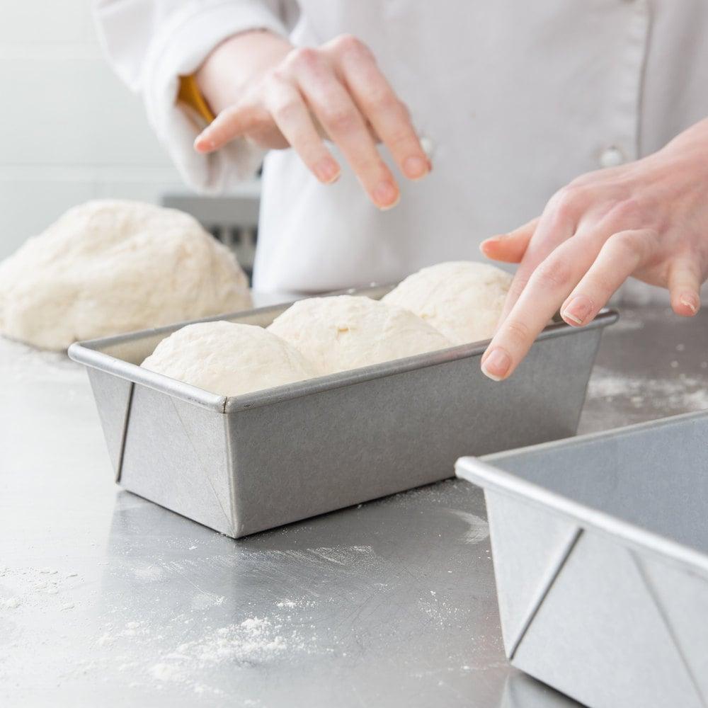 Proofed bread dough in an aluminized steel bread loaf pan