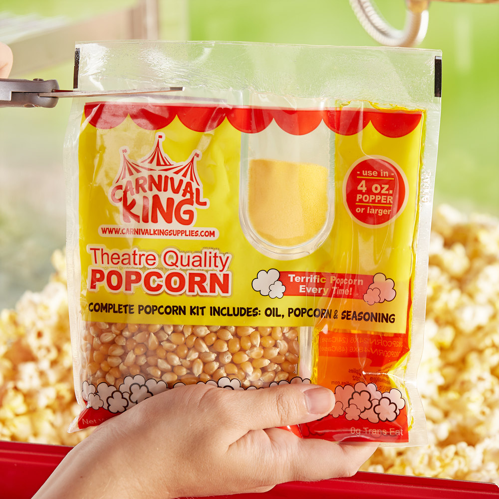 A person opening a popcorn kit