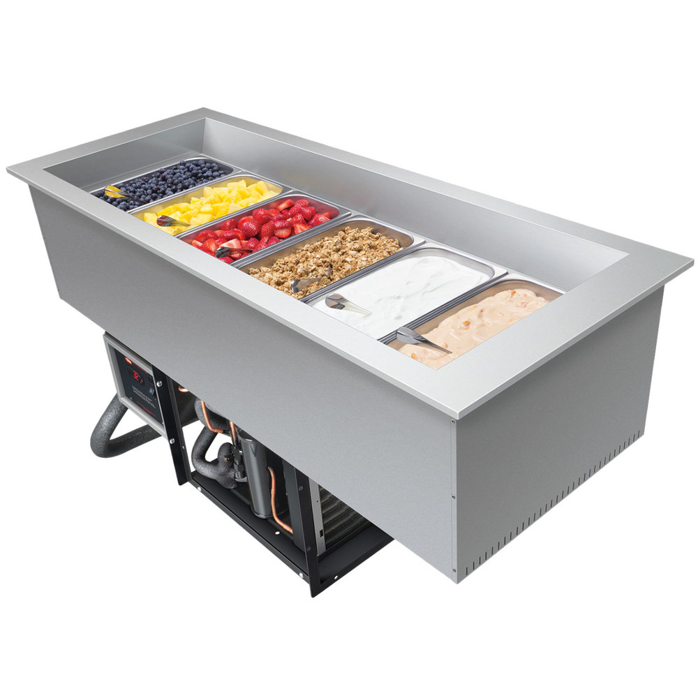 Refrigerated drop-in food well filled with 6 food pans full of fresh fruit and other desserts