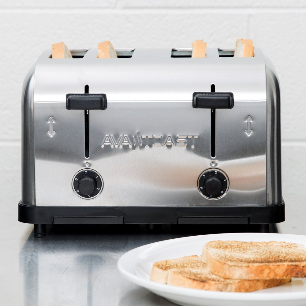 four slot pop-up toaster with bread and a plate of toast