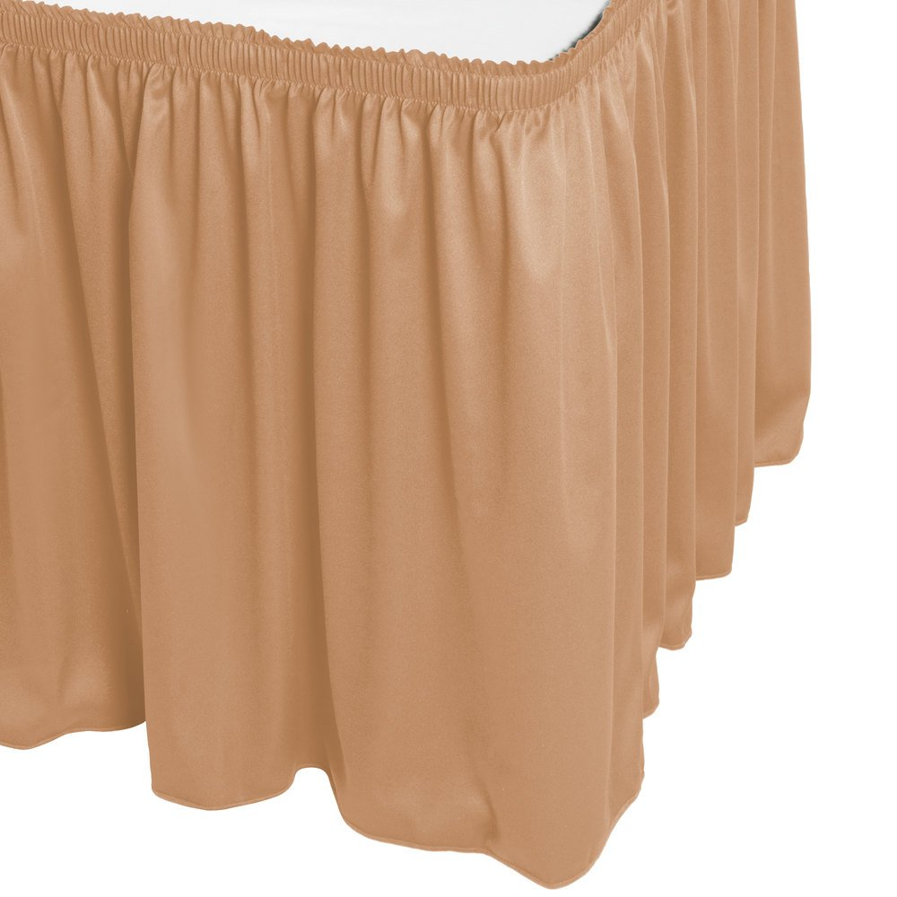 Gold box pleat table skirt is attached to a rectangular folding table