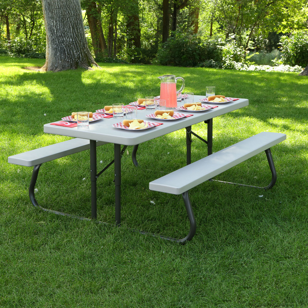 Lifetime putty folding picnic table set up with a picnic meal outdoors