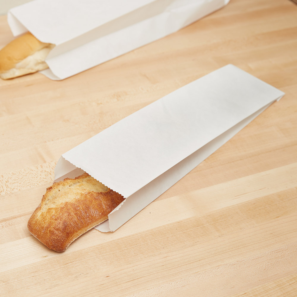 Step 4. When pan is hot, rub lightly with lard, then pour in 1/4 cup of the cornmeal mixture. Tilt pan, swirling batter to coat bottom. Cook until batter stops bubbling, begins to curl away from pan sides and is dry, 5 to 7 minutes. Slide a wide spatula under sheet of paper bread (the first sheet may be hard to handle), lift out.