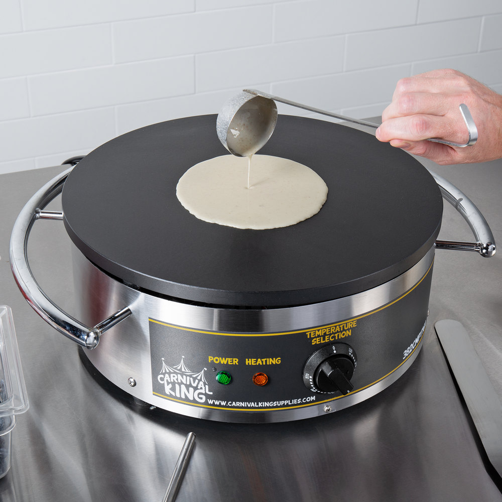 person spooning batter onto carnival king crepe maker with ladle