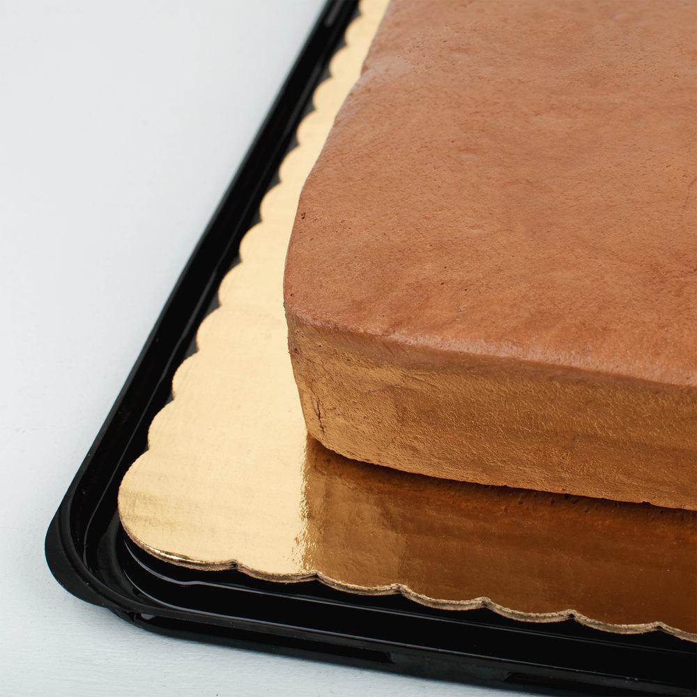 Gold laminated tarantula bake board corner in a plastic cake box