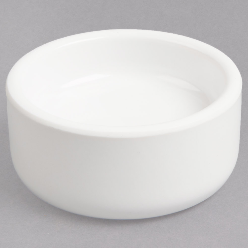 Small white melamine butter dish with round shape and straight sides