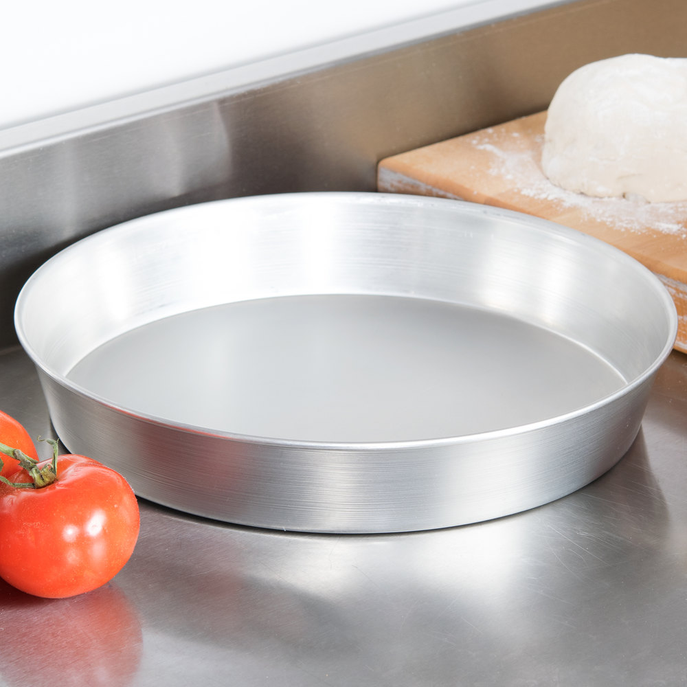 Tin-plated steel deep dish pizza pan on a counter