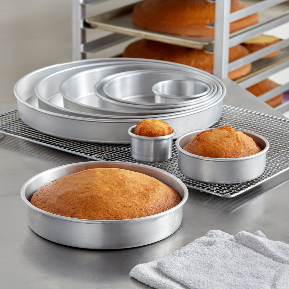 White cake in different sizes of cake pans