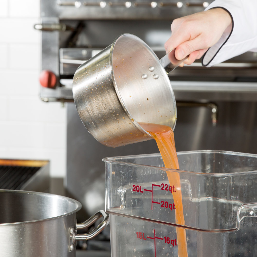 Town tapered 3 qt sauce pan pouring sauce into a storage container