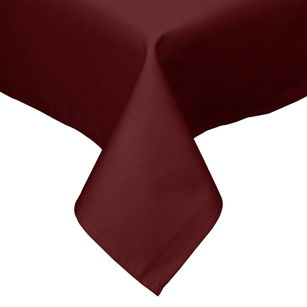 Burgundy cloth table cover drapes over a square edge