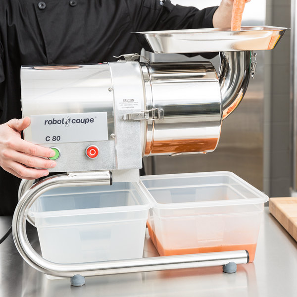 Chef juicing foods using a Robot Coupe sieve