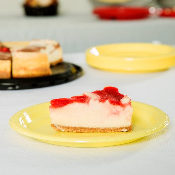 "Creative Converting 28102011 7"" Mimosa Yellow Plastic Plate - 240/Case"