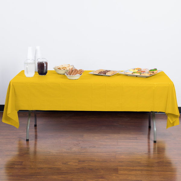 """Creative Converting 011012B 54"""" x 108"""" School Bus Yellow Disposable Plastic Table Cover - 24/Case"""