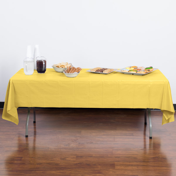 """Creative Converting 1252 108"""" x 54"""" Mimosa Yellow Disposable Plastic Table Cover - 12/Case Main Image 3"""