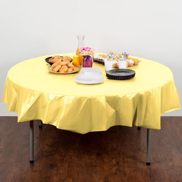 """Creative Converting 703266 82"""" Mimosa Yellow OctyRound Disposable Plastic Table Cover - 12/Case Main Image 4"""