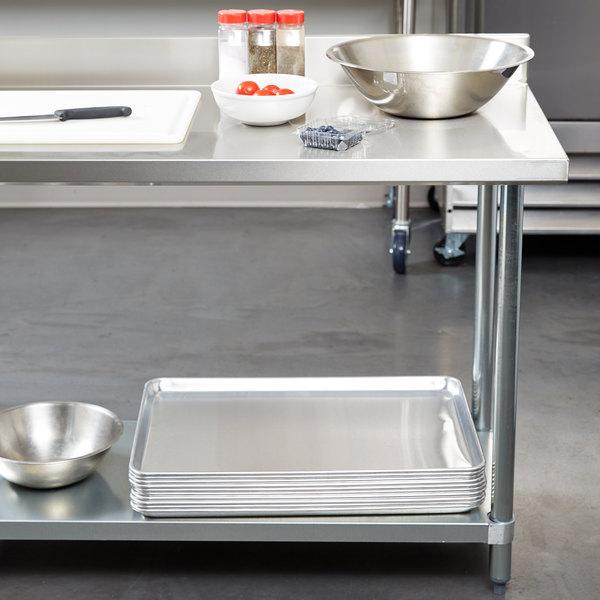 "Regency 24"" x 48"" 18-Gauge 304 Stainless Steel Commercial Work Table with 4"" Backsplash and Galvanized Undershelf Main Image 3"