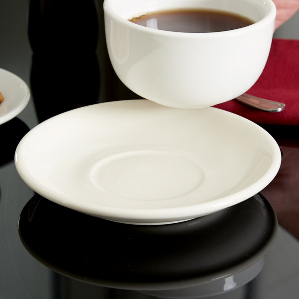 """Tuxton BEE-066 DuraTux 6 3/4"""" Ivory (American White) China Cappuccino Saucer - 24/Case"""