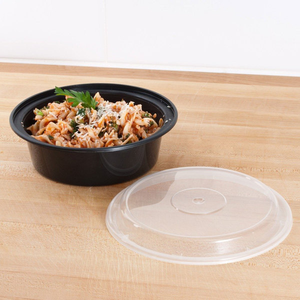 """Pactiv Newspring NC729B 32 oz. Black 7"""" VERSAtainer Round Microwavable Container with Lid - 150/Case"""