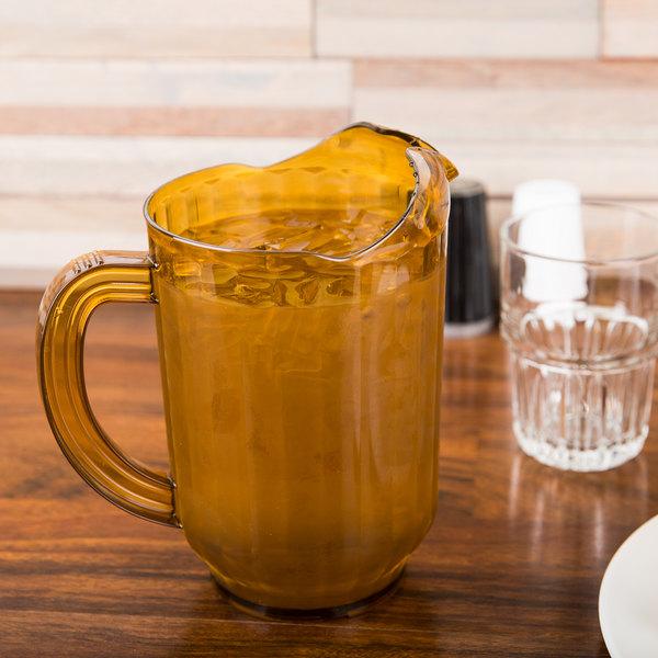 Carlisle 554013 VersaPour 60 oz. Amber Polycarbonate Beverage Pitcher