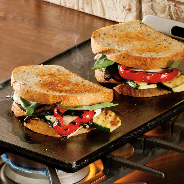 Cast iron griddle topped with toasted sandwiches