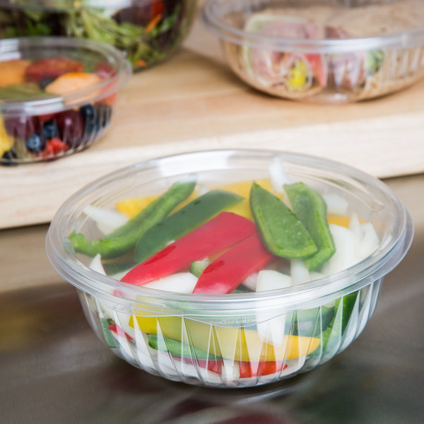 Dart C32HBF PresentaBowls 32 oz. Clear Hinged Plastic Bowl with Flat Lid - 75/Pack