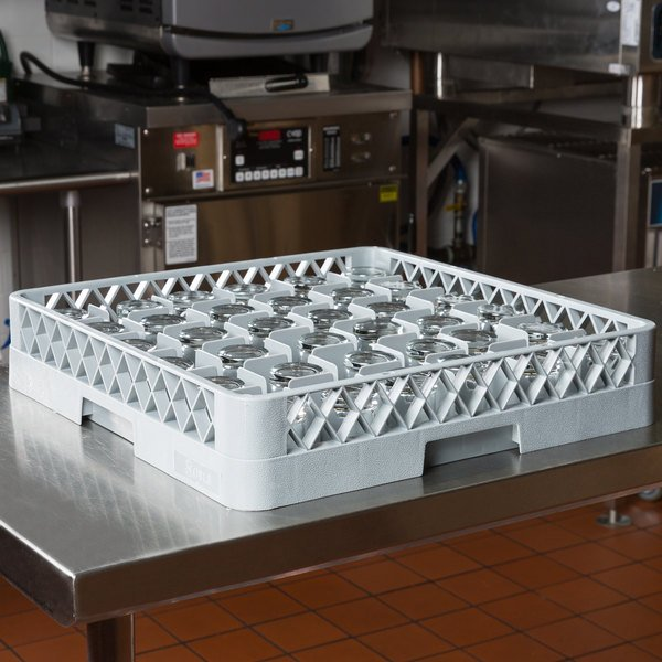Gray full size plastic glass rack on equipment table in commercial kitchen