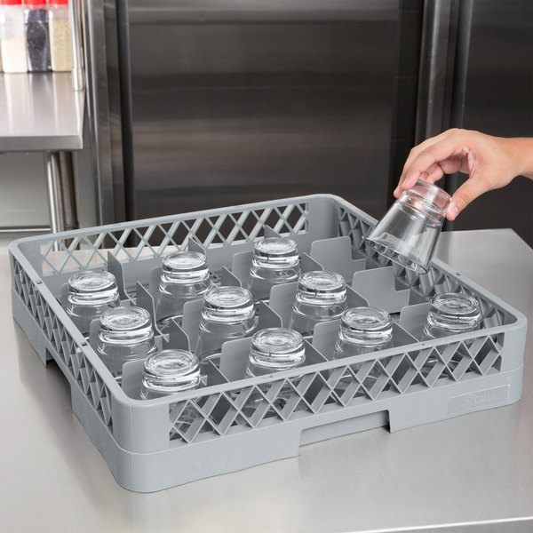 Gray plastic glass rack with 10 glasses inside and 1 glass being placed inside