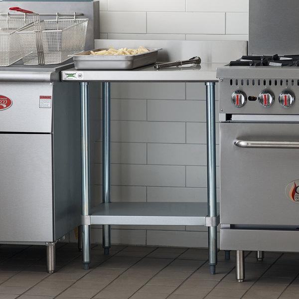 "Regency 24"" x 30"" 18-Gauge 304 Stainless Steel Commercial Work Table with 4"" Backsplash and Galvanized Undershelf Main Image 4"