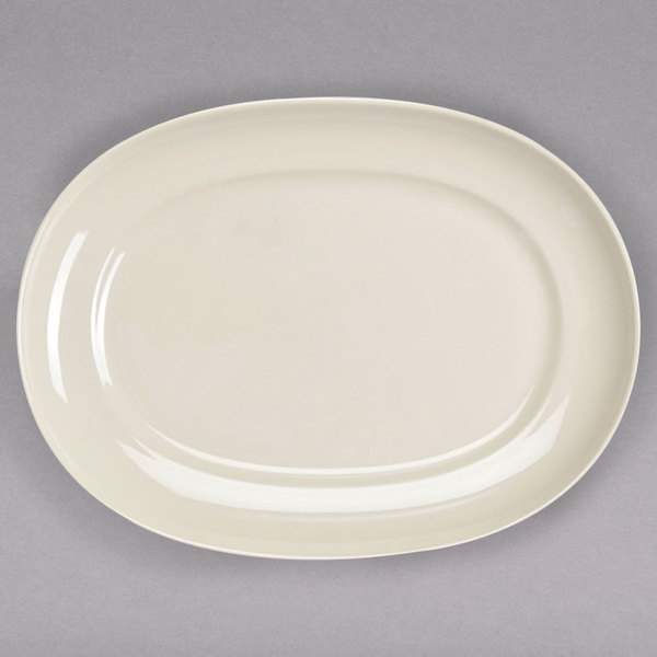 "Homer Laughlin by Steelite International HL12232100 RE-21 10"" x 7 9/16"" Ivory (American White) Oval China Platter - 24/Case Main Image 1"