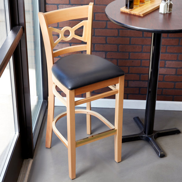 "Lancaster Table & Seating Natural Bow Tie Back Bar Height Chair with 2 1/2"" Padded Seat"