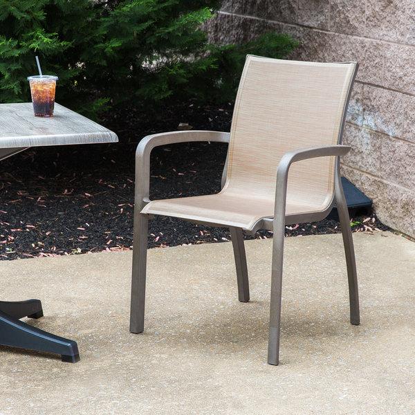 Grosfillex XA643599 / US643599 Monte Carlo Cognac / Fusion Bronze Outdoor Stacking Armchair & Grosfillex XA643599 / US643599 Monte Carlo Cognac / Fusion Bronze ...