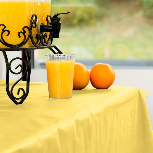 Creative Converting 013014 100' Mimosa Yellow Disposable Plastic Table Cover