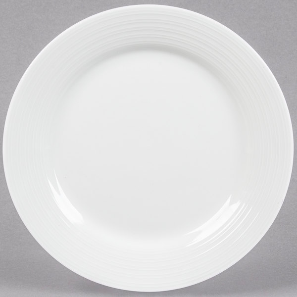 Bring style and sophistication to your tabletop with the Tuxton FPA-116 Pacifica 11 3/4  bright white embossed china plate! & Tuxton FPA-116 Pacifica 11 3/4
