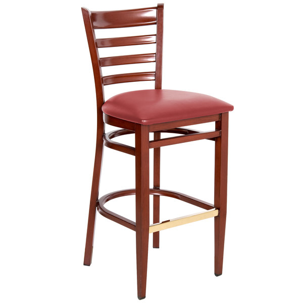 Preassembled Lancaster Table & Seating Spartan Series Bar Height Metal Ladder Back Chair with Mahogany Wood Grain Finish and Red Vinyl Seat