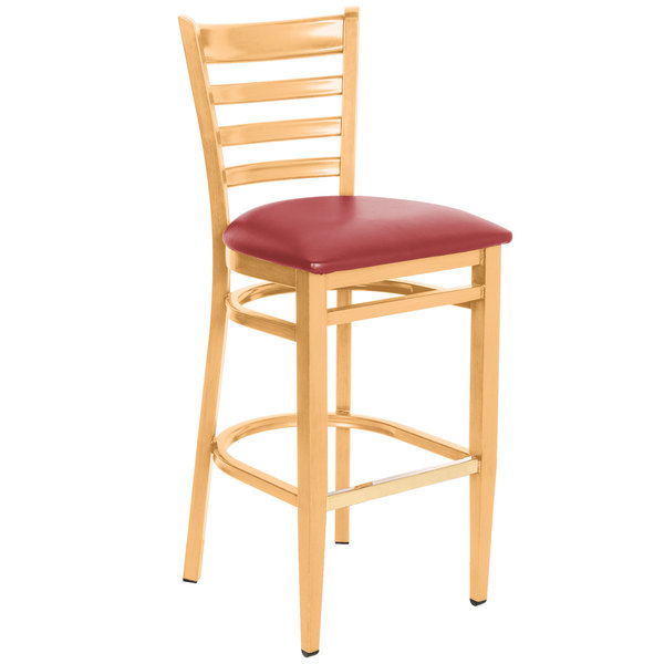 Preassembled Lancaster Table & Seating Spartan Series Bar Height Metal Ladder Back Chair with Natural Wood Grain Finish and Red Vinyl Seat