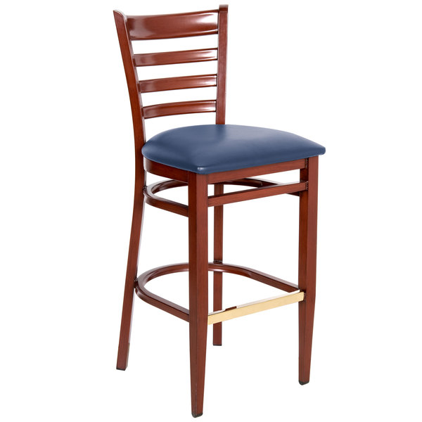 Knocked Down Lancaster Table & Seating Spartan Series Bar Height Metal Ladder Back Chair with Mahogany Wood Grain Finish and Navy Vinyl Seat
