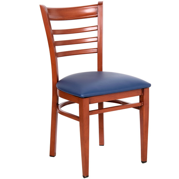 Preassembled Lancaster Table & Seating Spartan Series Metal Ladder Back Chair with Mahogany Wood Grain Finish and Navy Vinyl Seat
