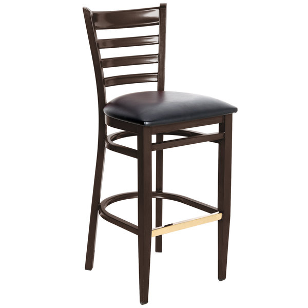 Preassembled Lancaster Table & Seating Spartan Series Bar Height Metal Ladder Back Chair with Walnut Wood Grain Finish and Black Vinyl Seat