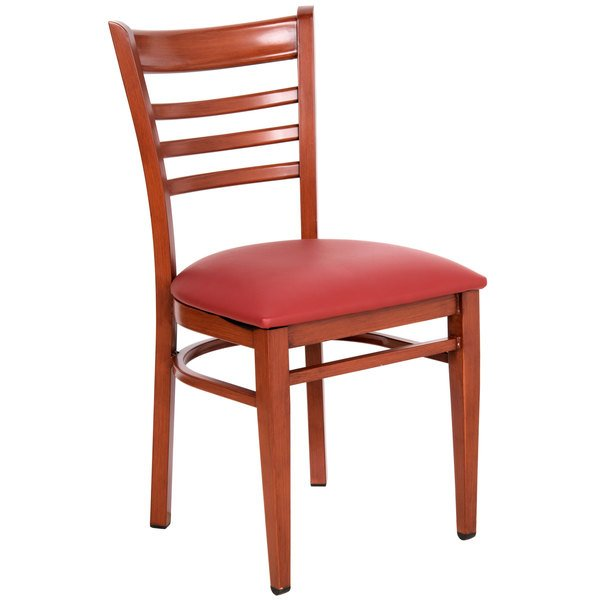 Assembled Lancaster Table & Seating Spartan Series Metal Ladder Back Chair with Mahogany Wood Grain Finish and Red Vinyl Seat