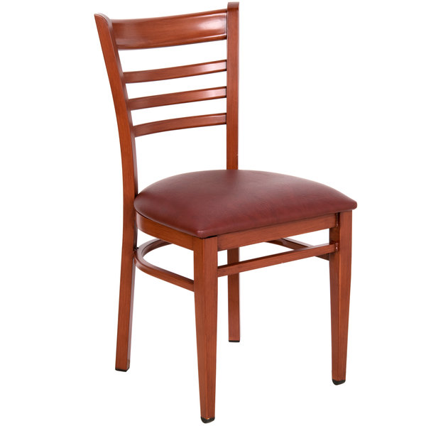 Preassembled Lancaster Table & Seating Spartan Series Metal Ladder Back Chair with Mahogany Wood Grain Finish and Burgundy Vinyl Seat