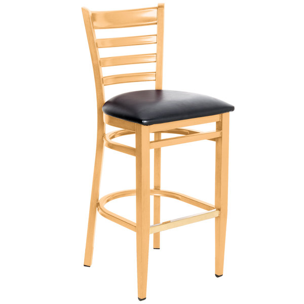 Knocked Down Lancaster Table & Seating Spartan Series Bar Height Metal Ladder Back Chair with Natural Wood Grain Finish and Black Vinyl Seat