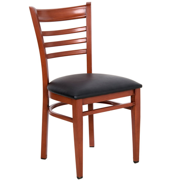 Preassembled Lancaster Table & Seating Spartan Series Metal Ladder Back Chair with Mahogany Wood Grain Finish and Black Vinyl Seat