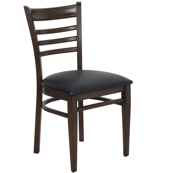 Preassembled Lancaster Table & Seating Spartan Series Metal Ladder Back Chair with Walnut Wood Grain Finish and Black Vinyl Seat