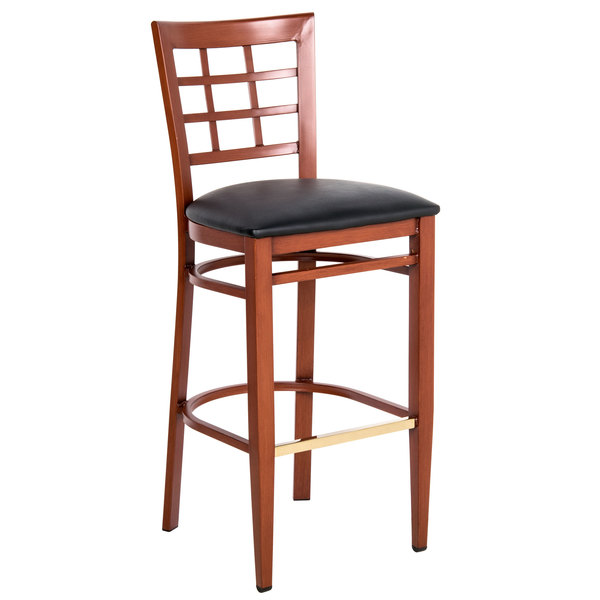 Assembled Lancaster Table & Seating Spartan Series Bar Height Metal Window Back Chair with Mahogany Wood Grain Finish and Black Vinyl Seat