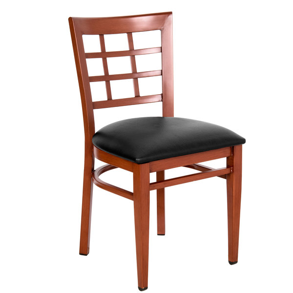 Assembled Lancaster Table & Seating Spartan Series Metal Window Back Chair with Mahogany Wood Grain Finish and Black Vinyl Seat
