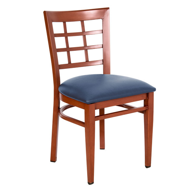 Assembled Lancaster Table & Seating Spartan Series Metal Window Back Chair with Mahogany Wood Grain Finish and Navy Vinyl Seat