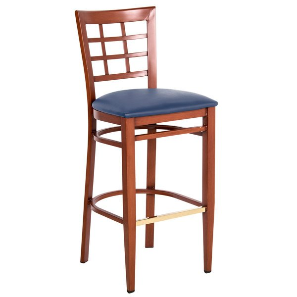 Assembled Lancaster Table & Seating Spartan Series Bar Height Metal Window Back Chair with Mahogany Wood Grain Finish and Navy Vinyl Seat